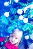 Christmas. Young Girl In Front Of Christmas Tree Stock Images