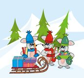Christmas. Three mice in colorful hats and scarves go decorate the tree. They're taking sleigh with gifts Stock Photography