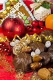 Christmas. Coloured Christmas jewellery, gingerbread and nuts Stock Photos