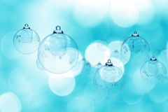 Christmas. Glassy Ornaments. Blue Bokeh Beautiful Holidays Theme. Great As Holidays /  Postcard For Your Company or Your Client. Bokeh  Lights. Baby Blue Color Royalty Free Stock Images