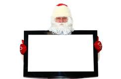 Christmas. Santa Claus near the TV Stock Image
