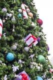 Christmas. Decorative Christmas balls and gift box on Christmas tree Stock Photo