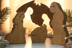 Christmas. Handmade wooden crib with lights in the background Stock Photo