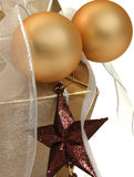 Christmas. Gift decorated with baubles and stars stock photos