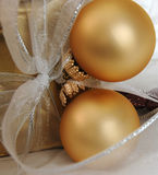 Christmas. Gift decorated with baubles and stars royalty free stock image