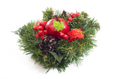 Christmas. Adornment of Christmas with pine, gifts and apple Stock Images
