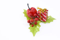 Christmas. Adornment. holly with fruit, gift and apple Stock Photo