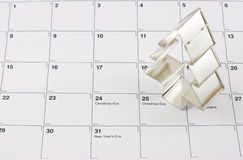 Christmas. Tree shaped cookie cutter placed on  Day in a December calendar Stock Images