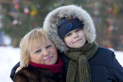 Christmas. The grandmother and the grandson on walk during Christmas Stock Photo