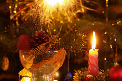 Christmas. Eve with candle and decorations Royalty Free Stock Photo