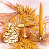 Christmas. Atmosphere with candle, bell and lighting tree Royalty Free Stock Image