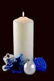 Christmas. Candle and ornaments isolated on black with clipping path Stock Photography