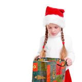 Christmas. Young girl with christmas cap and gift Royalty Free Stock Photography