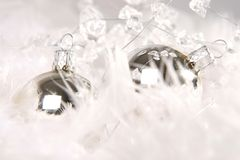 Christmas. Silver christmas ball with white feather royalty free stock image