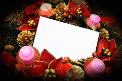 Christmas. A white paper note on christmas ornaments Stock Images
