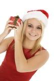 Beautiful Caucasain female holding gifts on white background Royalty Free Stock Photos