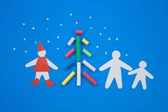 Christmas. Composition from color pencils and silhouettes of figures of the person Royalty Free Stock Images