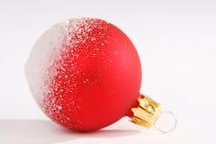 Christmas. Red christmas ball with snow stock image