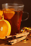 Christmas. Drink with cinnamon and orange royalty free stock images