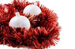 Christmas. Red balls and tinsel on white Stock Photo
