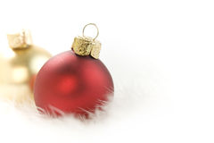 Christmas. Balls on white feather Royalty Free Stock Image