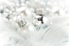 Christmas. Balls on white feather Royalty Free Stock Images