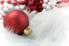 Christmas. Ball on white feather Royalty Free Stock Images