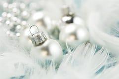 Christmas. Balls on white feather Royalty Free Stock Photos