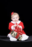 Christmas!. Her first Christmas and present Stock Images