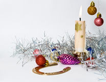 Christmas. Decoration with balls , horseshoe and candle  on white background Royalty Free Stock Image