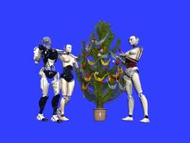 Christmas. Robots in eve of Christmas Stock Photos