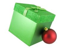 Christmas. Green gift box with red ornament isolated on white Royalty Free Stock Image