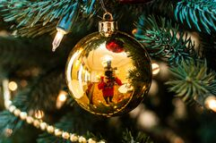 Free Christmas, A Self-portrait In A Christmas Ball That Hangs On A Green Tree Royalty Free Stock Photo - 184173185