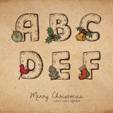 Christmas abc. Retro christmas alphabet - a, b, c, d, e, f - vintahe letters on realistic old parchment background, with symbols of holiday, decorative artistic Royalty Free Stock Photo