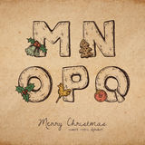 Christmas abc. Retro christmas alphabet - m, n, o, p, q - vintahe letters on realistic old parchment background, with symbols of holiday, decorative artistic Stock Photo