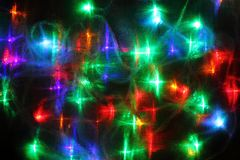 Christmas abstract background from color lights. As holiday texture royalty free illustration