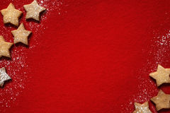 Christmas abstract background with cookies on red Royalty Free Stock Image