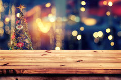 Christmas abstract background light bokeh from Xmas tree at night party in winter. Top of wood table with christmas abstract background light bokeh from Xmas Royalty Free Stock Photography