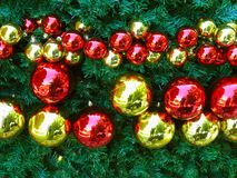 Christmas abstract background with shiny ball decorations on gre royalty free stock photo