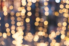 Christmas abstract blur background. Light bokeh from Xmas tree at night party in winter. vintage color tone Stock Photography