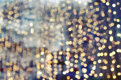 Christmas abstract blur background. Light bokeh from Xmas tree at night party in winter. vintage color tone Royalty Free Stock Image