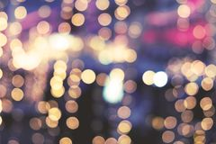 Christmas abstract blur background. Light bokeh from Xmas tree at night party in winter. vintage color tone Royalty Free Stock Photos