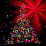 Christmas Abstract Bokeh Tree on light ray background Stock Images