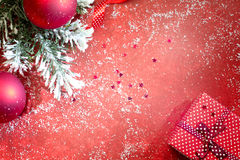 Christmas abstract red background with gift and fir Royalty Free Stock Image