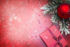 Christmas abstract red background with gift and fir Royalty Free Stock Photography