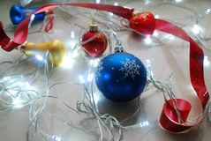 Christmas abstract set of ornaments and lights on neutral background. Royalty Free Stock Photography