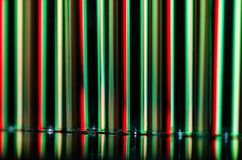 Abstract: Vertical Streaks of Red and Green Light Forming a Holiday Background Royalty Free Stock Photos