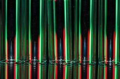 Christmas Abstract: Vertical Streaks of Red and Green Light Forming a Holiday Background Royalty Free Stock Photography