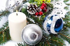 Christmas accessories in blue & fir tree branch Royalty Free Stock Photography