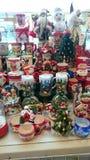 Christmas accessories - color, happy, seasonal gifts. Image of some Christmas gifts - seasonal accessories, colorful mugs, globes, Santa Claus, candles royalty free stock photos